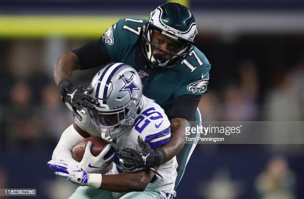 Xavier Woods of the Dallas Cowboys returns an interception against Alshon Jeffery of the Philadelphia Eagles in the second half at AT&T Stadium on...