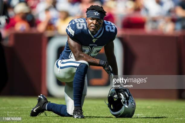 Xavier Woods of the Dallas Cowboys takes a knee during an injury timeout against the Washington Redskins during the first half at FedExField on...
