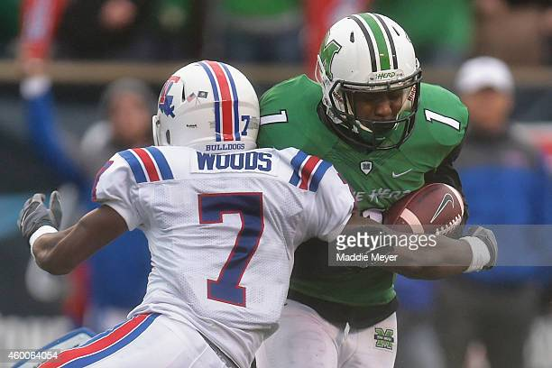 Xavier Woods of the Louisiana Tech Bulldogs tackles Tommy Shuler of the Marshall Thundering Herd during the third quarter at Joan C. Edwards Stadium...