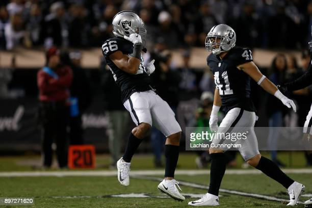 Xavier WoodsonLuster and Erik Harris of the Oakland Raiders celebrate after making a defensive play against the Dallas Cowboys at OaklandAlameda...