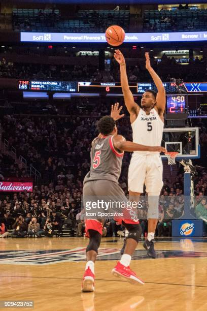 Xavier's Guard Trevon Bluiett shoots over St John's Guard Justin Simon during the BigEast tournament quarterfinal game featuring St John's Red Storm...