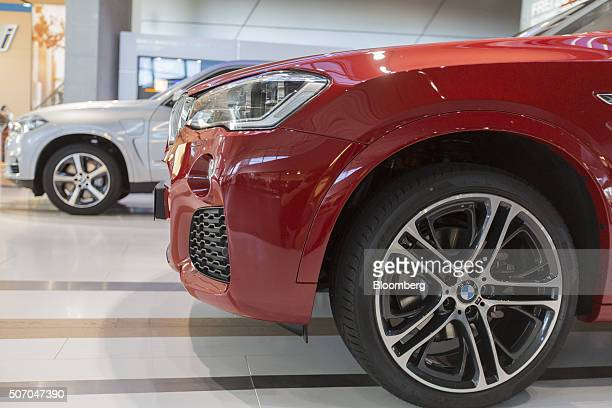 X4 xDrive luxury automobile produced by Bayerische Motoren Werke AG right sits on display inside the BMW World showroom in Munich Germany on Tuesday...