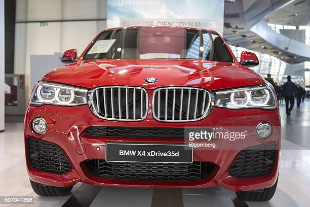 X4 xDrive luxury automobile produced by Bayerische Motoren Werke AG sits on display inside the BMW World showroom in Munich Germany on Tuesday Jan 26...