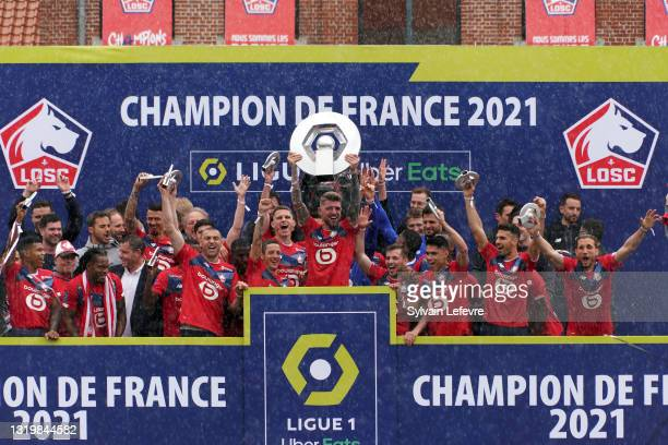 Xeka and players of Lille OSC celebrate their League 1 championship by receiving the Champions Trophy at training center of Luchin near Lille on May...