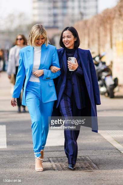 Xenia Adonts and Yoyo Cao are seen, outside BOSS, during Milan Fashion Week Fall/Winter 2020-2021 on February 23, 2020 in Milan, Italy.