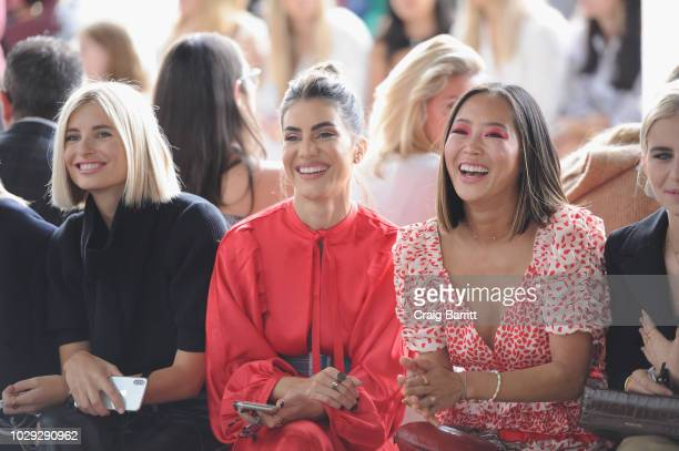 Xenia Adonts Camila Coelho and Aimee Song attend the SelfPortrait Spring Summer 2019 New York Fashion Week on September 8 2018 in New York City