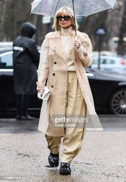 Xenia Adonts is seen wearing a Margiela outfit outside the Maison Margiela show during Paris Fashion Week: AW20 on February 26, 2020 in Paris, France.