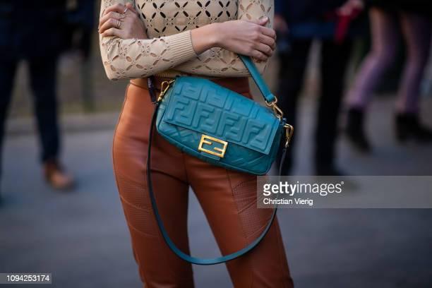 Xenia Adonts is seen wearing beige top brown leather pants Fendi bag white boots sunglasses outside Fendi during Milan Menswear Fashion Week...