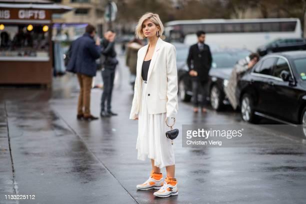 Xenia Adonts is seen wearing blazer, white skirt, mini Chloe bag, Chanel sneaker outside Haider Ackermann during Paris Fashion Week Womenswear...