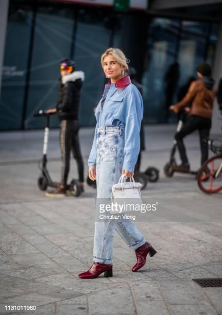 Xenia Adonts is seen wearing blue button shirt denim jeans white bag outside Alberta Ferretti on Day 1 Milan Fashion Week Autumn/Winter 2019/20 on...