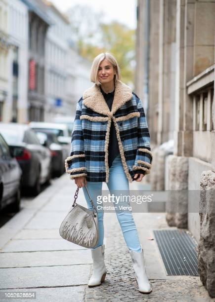 Xenia Adonts is seen wearing blue navy white plaid shearling jacket Miu Miu Fendi boots blue Acne pants black Celine blouse Loewe bag on October 20...