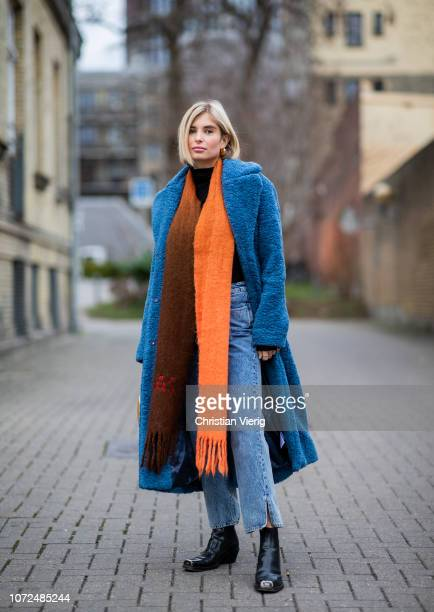 Xenia Adonts is seen wearing blue teddy coat orange brown two tone scarf denim jeans golden bag outside Samsoe Samsoe Autumn 2019 Resee on December...