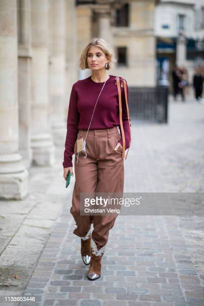 Xenia Adonts is seen wearing bordeaux jumper, brown bag, cowboy boots outside Thom Browne during Paris Fashion Week Womenswear Fall/Winter 2019/2020...