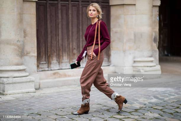 Xenia Adonts is seen wearing bordeaux jumper brown bag cowboy boots outside Thom Browne during Paris Fashion Week Womenswear Fall/Winter 2019/2020 on...