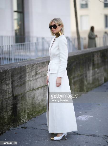 Xenia Adonts is seen wearing Bottega Veneta heels and a beige coat outside the Elie Saab show during Paris Fashion week Womenswear Fall/Winter...
