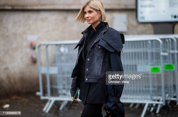 Xenia Adonts is seen wearing denim jacket outside Sacai during Paris Fashion Week Womenswear Fall/Winter 2019/2020 on March 04 2019 in Paris France