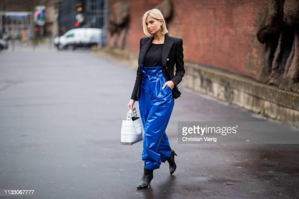 Xenia Adonts is seen wearing high waist blue pants black blazer outside Balmain during Paris Fashion Week Womenswear Fall/Winter 2019/2020 on March...