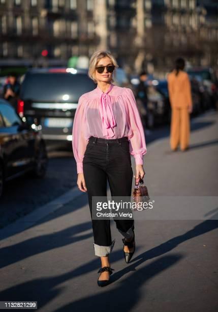 Xenia Adonts is seen wearing pink blouse black denim jeans outside Rochas during Paris Fashion Week Womenswear Fall/Winter 2019/2020 on February 27...