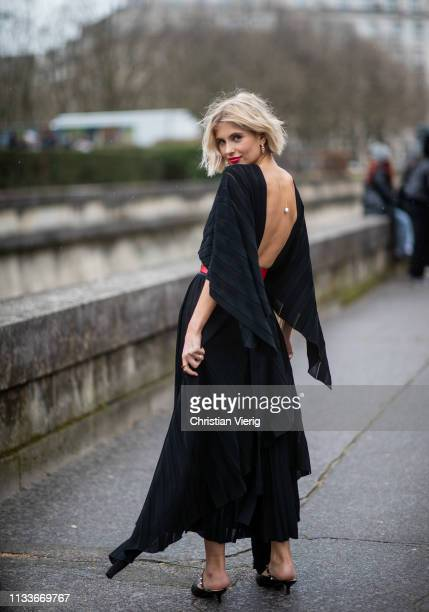 Xenia Adonts is seen wearing red belt black belted dress outside Valentino during Paris Fashion Week Womenswear Fall/Winter 2019/2020 on March 03...