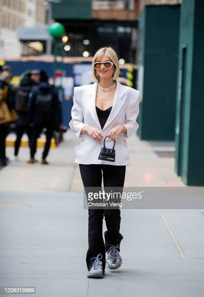 Xenia Adonts is seen wearing white blazer micro bag black pants outside Michael Kors during New York Fashion Week Fall / Winter 2020 on February 12...