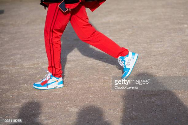 Xenia Adonts Nike sneakers details is seen in the streets of Paris before the OffWhite show on January 16 2019 in Paris France