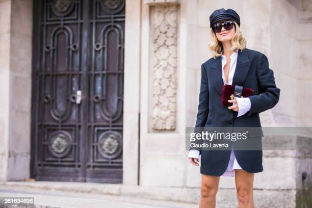 Xenia Adonts Overdose wearing long jacket and Prada bag is seen in the streets of Paris before the Cerruti 1881 show during Paris Men's Fashion Week...