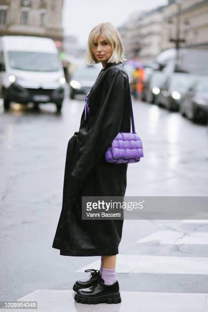 Xenia Adonts poses wearing Stella McCartney and a Bottega Veneta bag after the Stella McCartney show at the Opera Garnier during Paris Fashion Week...
