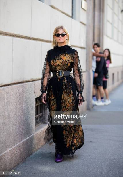 Xenia Adonts seen wearing belted sheer dress with print outside the Etro show during Milan Fashion Week Spring/Summer 2020 on September 20 2019 in...
