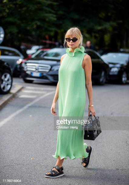 Xenia Adonts seen wearing black bag sandals green dress outside the Tod's show during Milan Fashion Week Spring/Summer 2020 on September 20 2019 in...