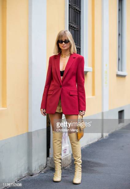 Xenia Adonts seen wearing two tone beige black boots red blazer yellow brown bag outside Boss during Milan Fashion Week Spring/Summer 2020 on...