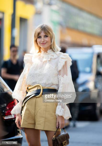 Xenia Adonts seen wearing white blouse mustard high waist shorts mini Fendi bag outside the Marni show during Milan Fashion Week Spring/Summer 2020...