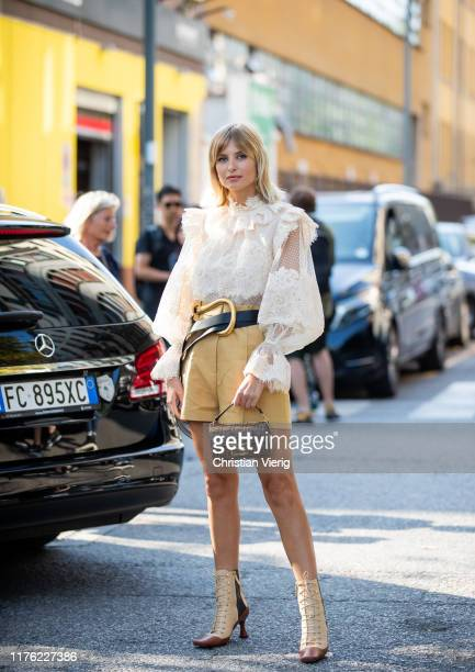 Xenia Adonts seen wearing white blouse, mustard high waist shorts, mini Fendi bag outside the Marni show during Milan Fashion Week Spring/Summer 2020...
