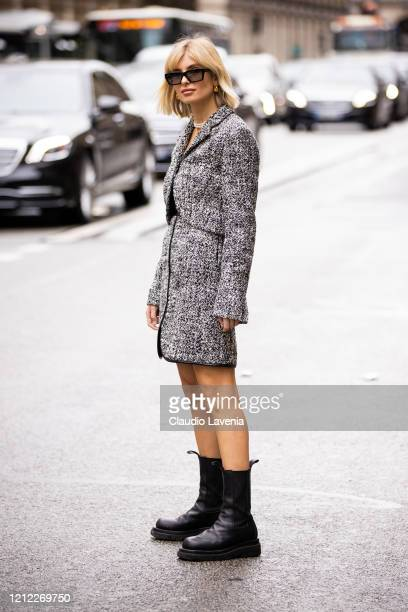Xenia Adonts wearing a black and white jacket with matching skirt and black boots is seen outside Giambattista Valli during Paris Fashion Week...