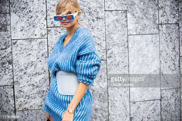 Xenia Adonts, wearing a blue and white striped wool dress is seen outside the Sportmax show during Milan Fashion Week Spring/Summer 2020 on September...