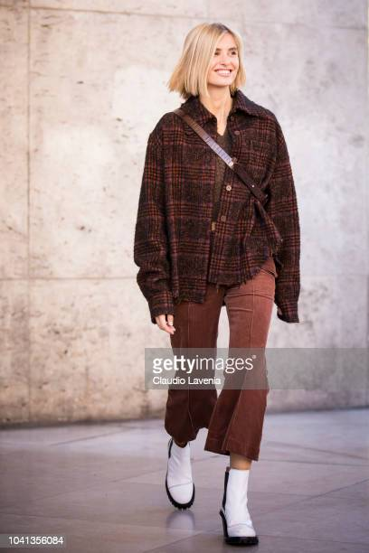 Xenia Adonts, wearing a brown checked jacket, brown cropped trousers and white boots, is seen before the Guy Laroche show on September 26, 2018 in...