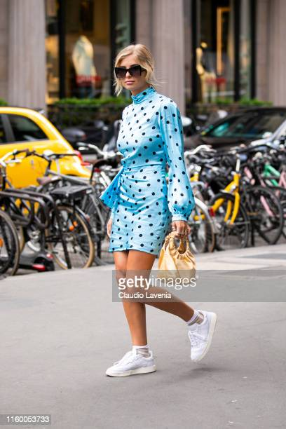 Xenia Adonts wearing a light blue and black polka dot dress white sneakers and yellow bag is seen outside Schiaparelli show during Paris Fashion Week...