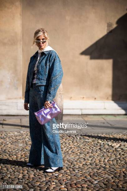 Xenia Adonts, wearing a purple Maison Margiela bag and denim jacket and pants, is seen outside Etro on Day 3 Milan Fashion Week Autumn/Winter 2019/20...