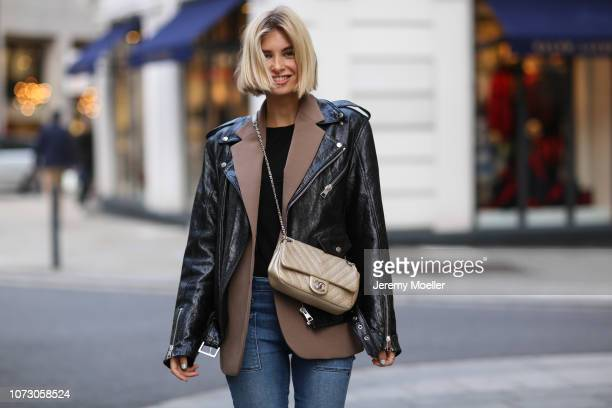 Xenia Adonts wearing Alexa Chung boots Mathis Clothing leather jacket RTA jeans Frankie Shop blazer Chanel bag and a ysl tshirt on November 26 2018...