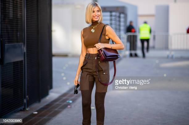 Xenia Adonts wearing brown cropped top brown pants boots and Chloe bag is seen outside Chloe during Paris Fashion Week Womenswear Spring/Summer 2019...