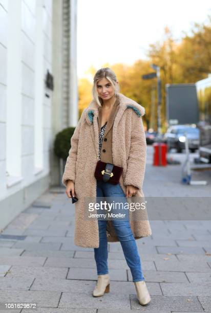 Xenia Adonts wearing Fabrizio Viti shoes jeans from RTA top Anine Bing bag from Prada coat from Baum Pferdgarten and earringss from Tory Burch on...