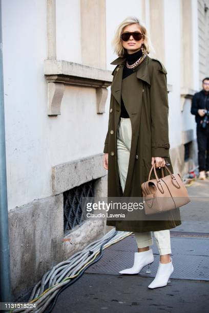 Xenia Adonts, wearing green trench coat, is seen outside Tod's on Day 3 Milan Fashion Week Autumn/Winter 2019/20 on February 22, 2019 in Milan, Italy.