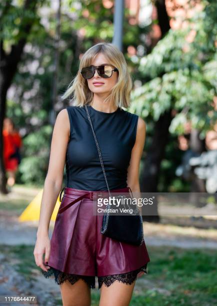 Xenia Adonts wearing mini skirt, black top seen outside the Philosophy show during Milan Fashion Week Spring/Summer 2020 on September 21, 2019 in...