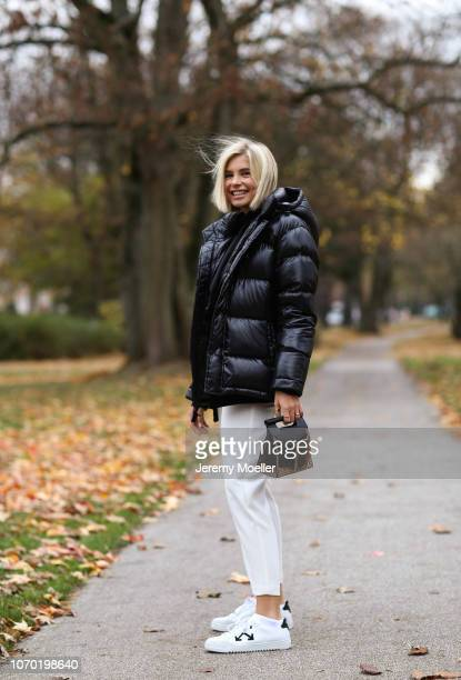 Xenia Adonts wearing Off White shoes Aritzia puffer jacket Mango blazer Topshop trousers and Boyy bag on November 20 2018 in Hamburg Germany