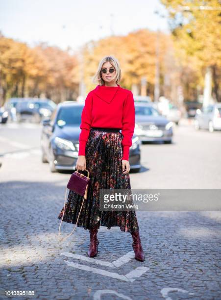 Xenia Adonts wearing red knit midi skirt is seen outside Elie Saab during Paris Fashion Week Womenswear Spring/Summer 2019 on September 29 2018 in...