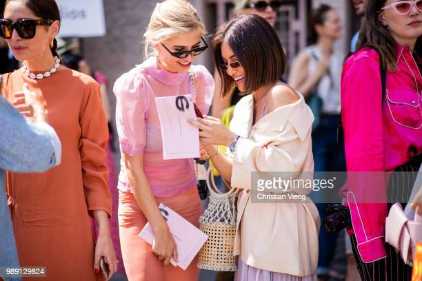 Xenia Adonts wearing sheer pink blouse and pencil skirt, Chanel bag seen outside Acne Studios during Paris Fashion Week Haute Couture FW18 on July 1,...