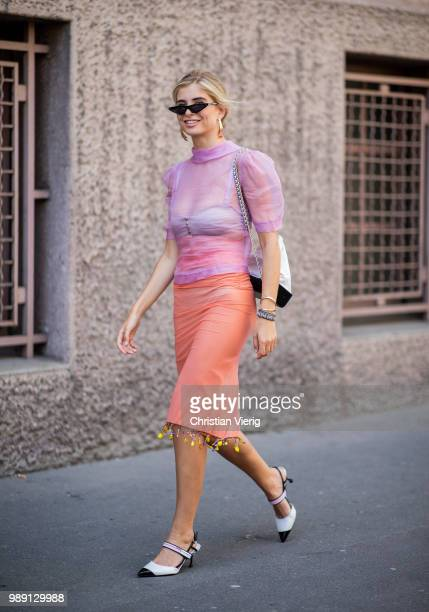 Xenia Adonts wearing sheer pink blouse and pencil skirt Chanel bag seen outside Acne Studios during Paris Fashion Week Haute Couture FW18 on July 1...