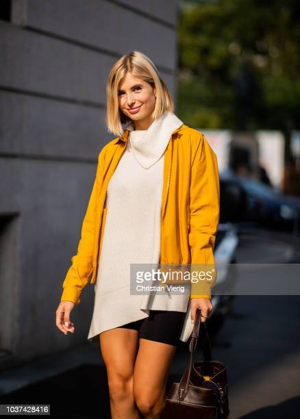 Xenia Adonts wearing white knit cycle pants yellow jacket is seen outside Tods during Milan Fashion Week Spring/Summer 2019 on September 21 2018 in...