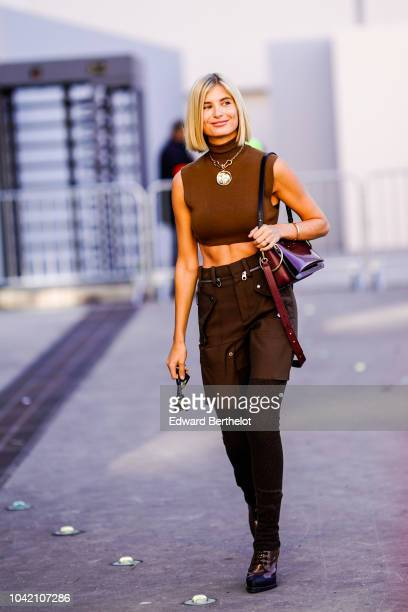 Xenia Adonts wears a brown cropped bare belly wool top brown shorts sunglasses a purple bag outside Chloe during Paris Fashion Week Womenswear...