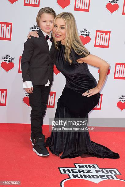 Xenia Seeberg and her son Philias Martinek attend the Ein Herz Fuer Kinder Gala 2014 at Tempelhof Airport on December 6 2014 in Berlin Germany