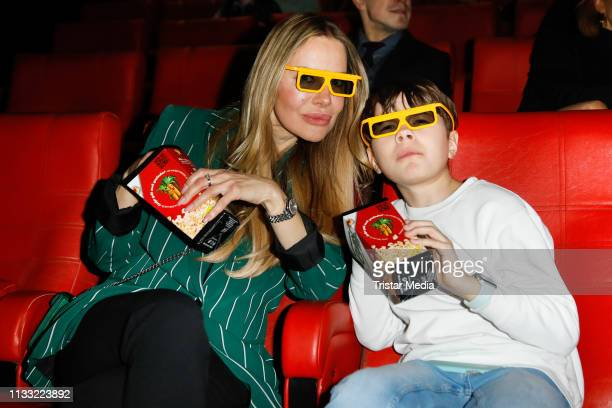 Xenia Seeberg and her son PhilipElias Martinek attend the premiere of the film LEGO City Cops In Action at LEGOLAND Discovery Center Berlin on March...